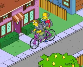 still from The Simpsons, Mr. Burns riding on the back of Smither's bike and not pedaling